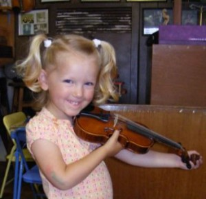 Little girl holding violin